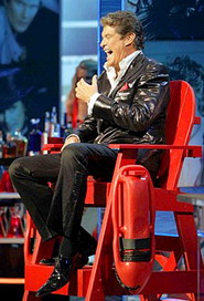 David Hasselhoff in a red lifeguards chair being roasted by Baywatch star Pamela Anderson, Jeffrey Ross and other comedians and celebrities at the 15th Comedy Central Roast