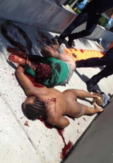 Miami cannibal attacker crime scene photo a dead Rudy Eugene lying next to his critically injured face eaten off victim Ronald Poppo on the MacArthur Causeway in Miami FL